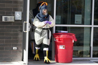 Nurse Lee Cherie Booth gets ready to administer coronavirus tests dressed as a turkey outside the Salt Lake County Health Department in Salt lake City, Utah, US.
