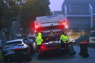A truck collecting residential waste along Macauley Street in Leichhardt.