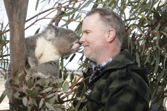 James Fitzgerald from Two Thumbs Wildlife Trust with Paul the Koala, named after First Officer Paul Hudson, one of the American firefighters who died in a plane crash while protecting the property.