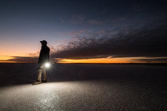 Farmer Rohan Mott on Lake Tyrrell at dawn.