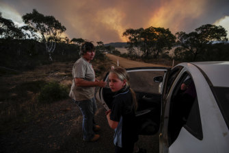 Ten-year-old Kasey Butcher, right, near the North Black Range bushfire on Friday.