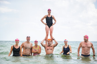 Shrinkäge swim group at Elwood Beach (from left): Holly Kent, Ross Pollard, Kendra Wright, Jamie Lingham, Amy Bennison (on shoulders), Lynn and Torben Vedelsby.