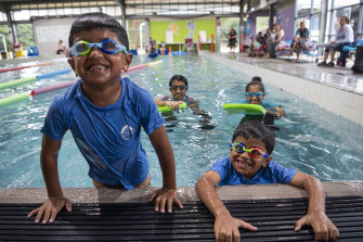 Twins Eesa and Aadil Kayani, six, having swimming lessons at Sydney's Holsworthy Aquatic Centre.