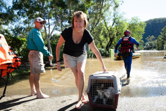 The SES rescue Angela Stewart and her pets from her home in Lower MacDonald.