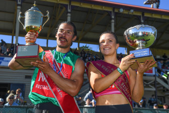 Edward Ware (left) and Hayley Orman hold their trophies after winning their races during the 139th running of the Stawell Gift at Central Park.