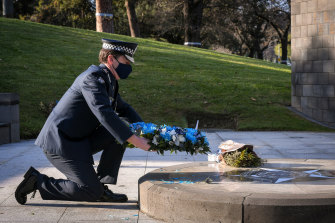 Chief Commissioner Shane Patton laying a wreath at the Victoria Police memorial.