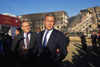President George W. Bush and Secretary of Defence Donald Rumsfeld visit the Pentagon in Washington DC to view the damage the day after the September 11, 2001 attacks.