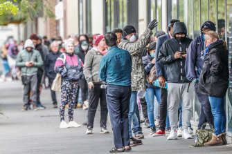 As the coronavirus pandemic took hold in Australia, thousands of people lost their jobs. Melburnians pictured here are lining up at Centrelink's South Melbourne office on March 25.