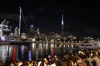 Crowds – yes, crowds – wait for the fireworks to start in Auckland.