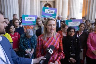 Maribyrnong councillor Sarah Carter addresses the rally at Parliament House on Thursday.