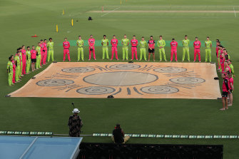 Sixers and Thunder players take part in a barefoot circle before last week's Sydney Smash in Canberra.