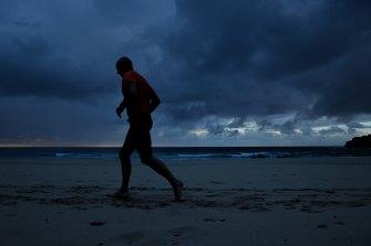 A man jogs along Bondi Beach in Sydney's east on Wednesday morning.