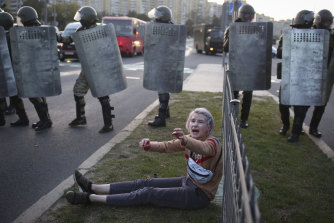 A woman reacts in front of police line during a rally in Minsk, Belarus, last week.