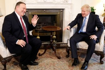 US Secretary of State Mike Pompeo and British Prime Minister Boris Johnson discuss the role of Huawei in British 5G networks at Downing Street on Thursday.
