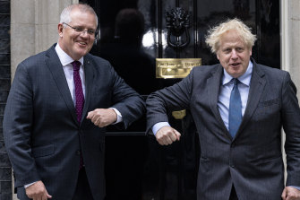 Prime Minister Scott Morrison is greeted by British PM Boris Johnson outside 10 Downing Street, London, on Monday.