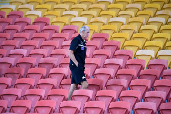 Rabbitohs coach Wayne Bennett walks through an empty grandstand at Suncorp Stadium on full-time against Brisbane last week.