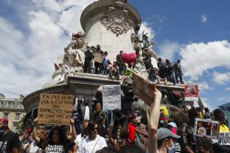 Thousands of people take part in a march against police brutality and racism in Paris, France, on Saturday June 13.