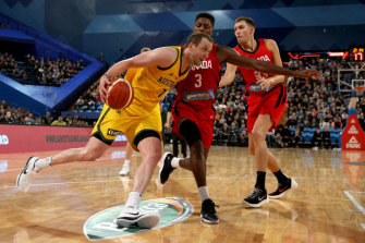Joe Ingles (left) of the Boomers drives past Melvin Ejim of Canada.