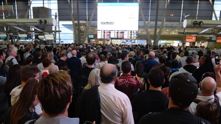 Airport staff reopened screening just before 7am, but delays were expected to last a while.