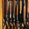GUN GUNS WEAPONS RACK CABINET GENERIC. iStock shotguns; firearms