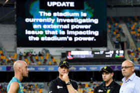 Dim view: Chris Lynn (left) of the Heat is seen talking to the match officials.