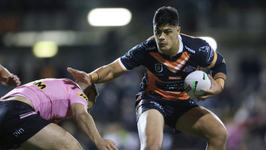 Tommy Taulau tries to evade the Panthers defence.