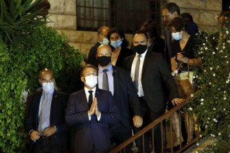 French President Emmanuel Macron and his entourage leave the house of Lebanese diva Fairouz, one of the Arab world's most popular singers, on Monday night.