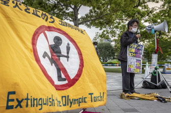 A protester speaks during a protest against the Tokyo Olympics, where concerns lingers over the feasibility of hosting the event amid a pandemic.