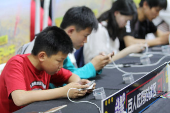 Young Chinese gamers play Tencent's popular Honour of Kings adventure game.