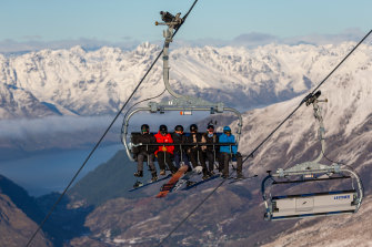 Skiers ride on the Coronet Express Chairlift at Coronet Peak, in Queenstown, New Zealand, last week.
