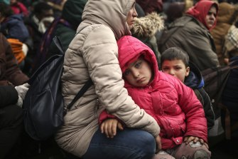 Migrants gather between Pazarkule border gate in Turkey and Kastanies border gate  as they try to enter Greece.