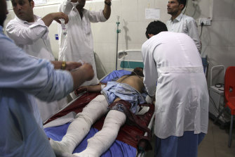 A wounded man receives treatment at a hospital after a suicide car bomb and attack by multiple gunmen in Jalalabad, east of Kabul, on Sunday.