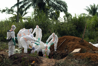 An Ebola victim is put to rest at the Muslim cemetery in Beni, Congo, last year.