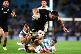 A rampaging Luke Jacobson storms forward for the All Blacks during their 39-point shutout of Argentina.