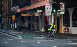 Cyclists take advantage of the quiet streets during Sydney's lockdown.