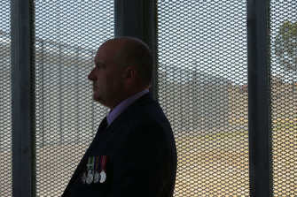 Then-Corrections Minister David Elliott attends a prison opening in 2018.