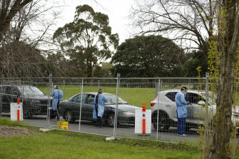 Cars lining up at a testing site at Albert Park on Monday. Some testing sites have started turning people away as they reach capacity.