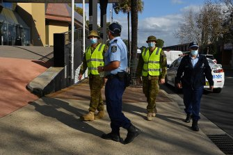 Police and the Australian Defence Force patrol the streets of Bankstown, one of the LGAs with strict restrictions allowing only healthcare and emergency service essential workers to leave the area during the lockdown.