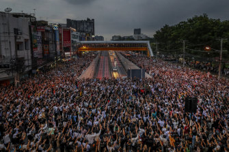Not alone: Pro-democracy activists in Bangkok on Monday.