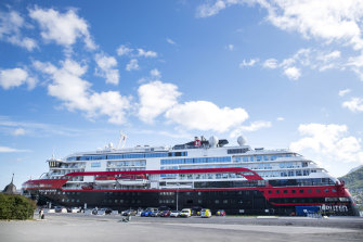Hurtigruten's MS Roald Amundsen, docked in Tromso, Norway on Sunday. Authorities are trying to trace passengers who have already left the ship.