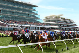 Packed crowds watch as Vow And Declare wins the Melbourne Cup.