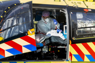 A COVID-19 patient is flown from the Netherlands, where hospitals have been swamped with virus patients, to Germany for treatment.