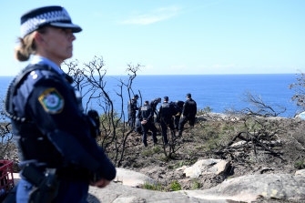 Police undertake a search at North Head near Manly on Tuesday following an arrest.