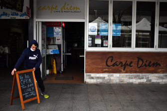 Cafe owner Sam Aldoumany at the deserted Liverpool mall this morning.