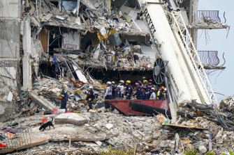 Crews work in the rubble of Champlain Towers South in Surfside on Tuesday.