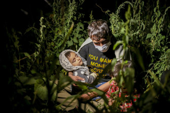 Afghan migrants sit in the countryside in Tatvan, in Bitlis Province, eastern Turkey, last week.