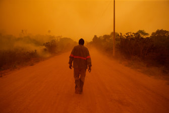 A volunteer firefighter walks along Transpantaneira road at the Pantanal wetlands region in Porto Jofre city, Mato Grosso state.
