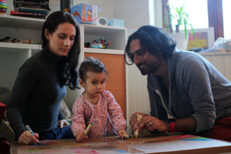 Ketan Joshi, right, and his wife Kim play with their daughter Amelia in home quarantine in Oslo, Norway.