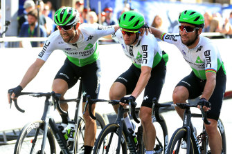 Teammates Bernhard Eisel (left) and Mark Cavendish (right) rally around Mark Renshaw (centre) in his last race.