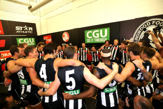 Collingwood players celebrate after the game.